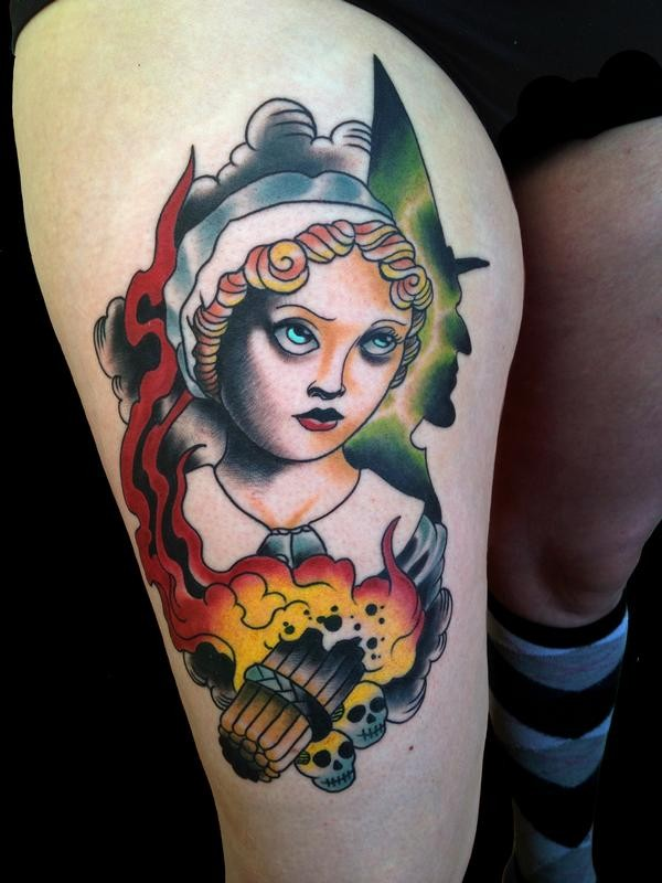 New school style colored thigh tattoo of creepy woman with skulls