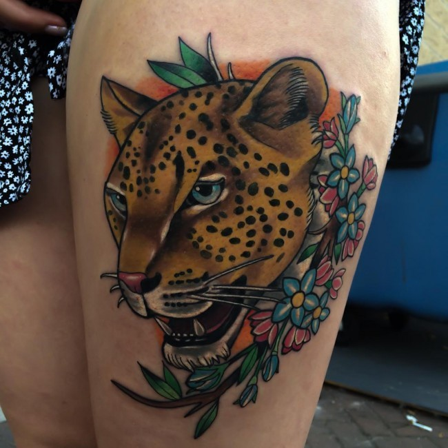New school style colored thigh tattoo of leopard and flowers
