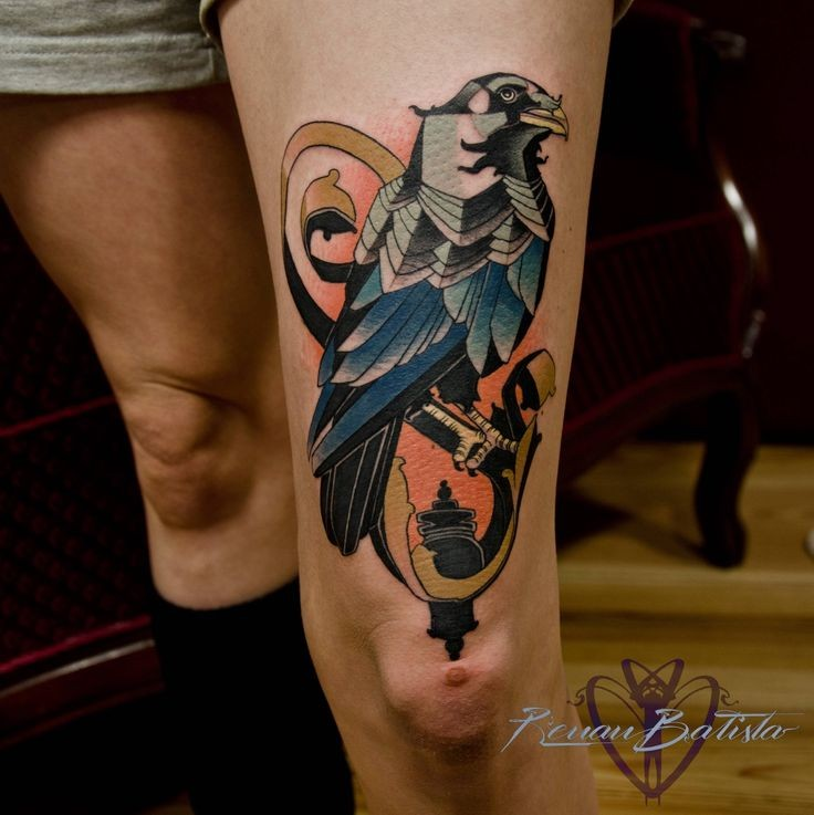 New school style colored thigh tattoo of big bird and lighter