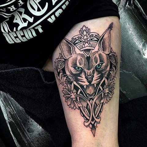New school style colored thigh tattoo of caracal with flowers