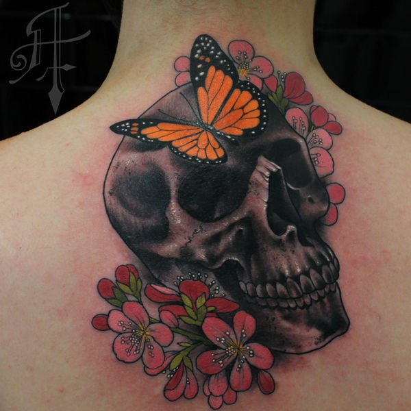 New school style colored upper back tattoo of human skull with flower and butterfly