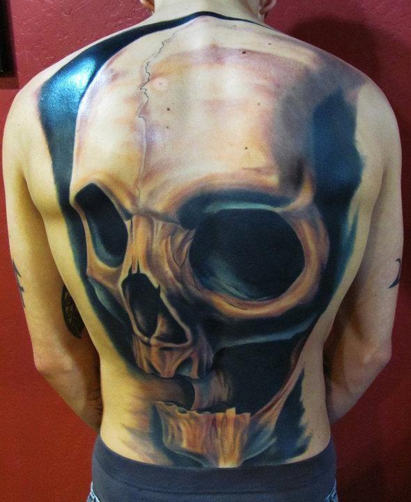 New school style colored whole back tattoo of impressive skull