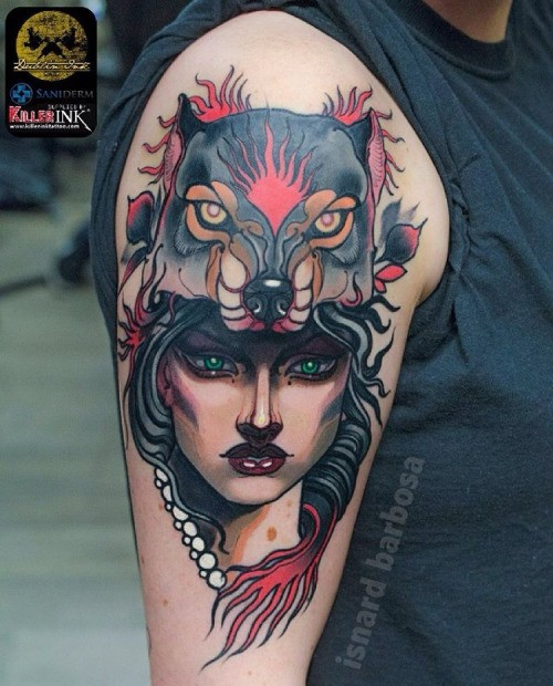 New school style colored witch portrait tattoo on shoulder with demonic wolf helmet