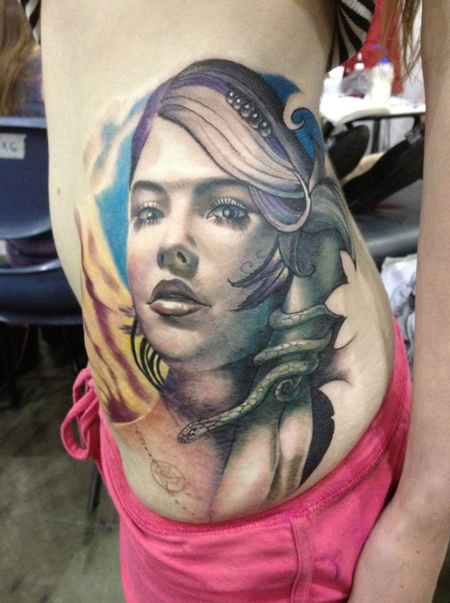 New school style colored woman portrait with snake