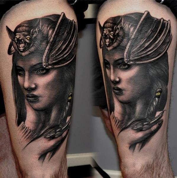 New school style colored woman portrait with with bat tattoo on thigh