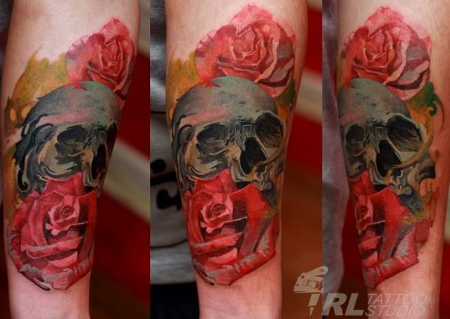 New school style colorful forearm tattoo of human skull with roses