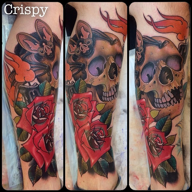 New school style colroed leg tattoo of human skull with bat and flowers