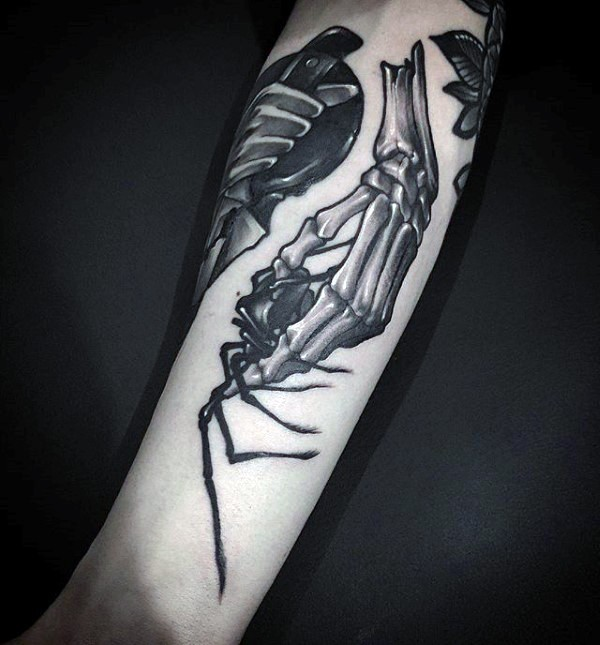 New school style detailed looking tattoo of skeleton hand holding spider