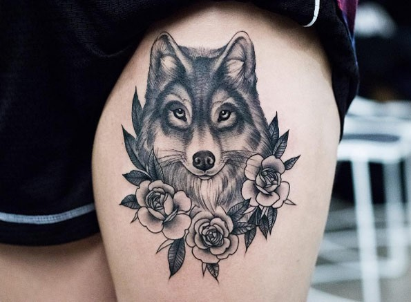 New school style detailed thigh tattoo of beautiful wolf with flowers