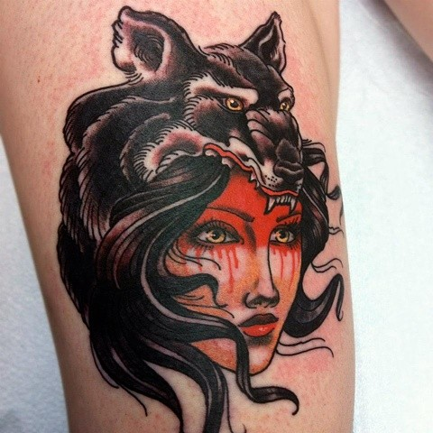 New school style woman face tattoo with wolf skin helmet