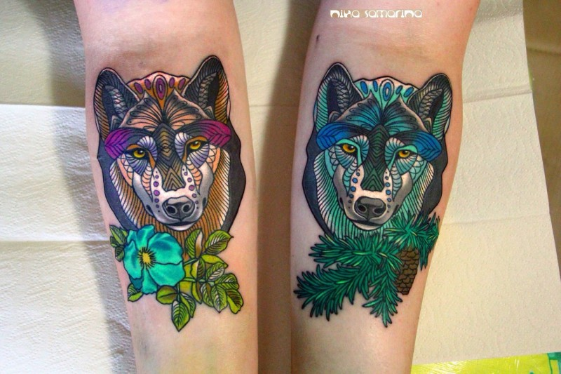 New school various looking colored forearms tattoo of wolf faces with flowers