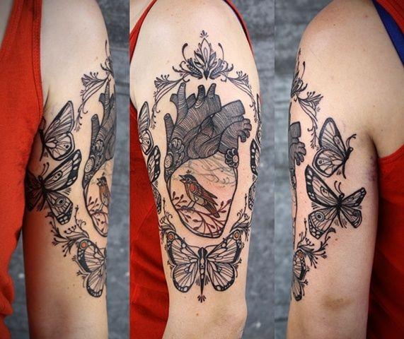 New style black lines heart tattoo on arm