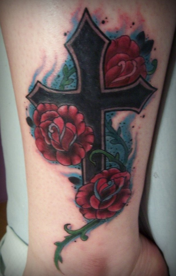 Nice black cross with red roses tattoo