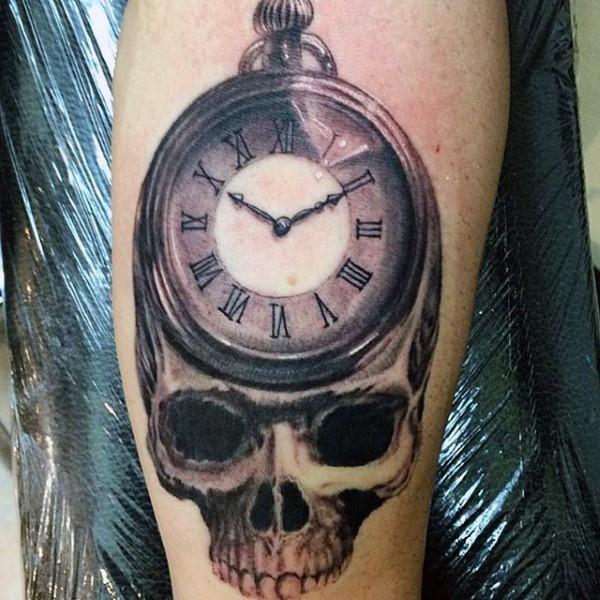 Nice black ink detailed skull with clock tattoo on leg
