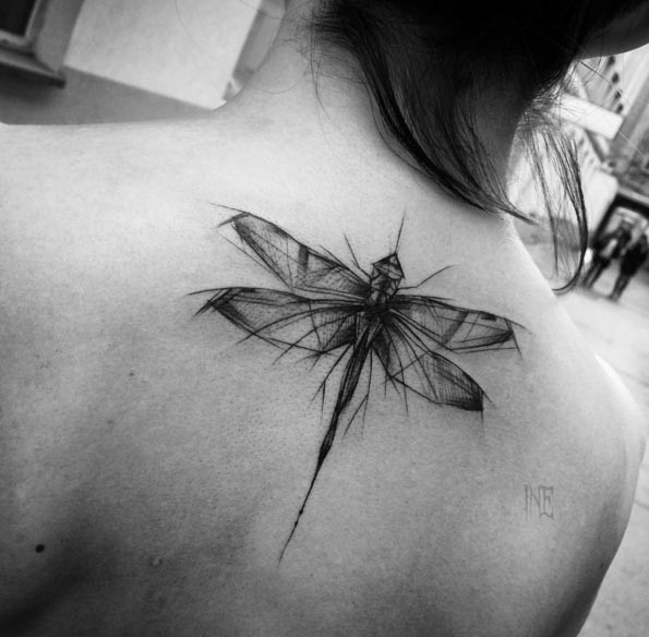 Nice black ink natural looking sketch style upper back tattoo of dragonfly