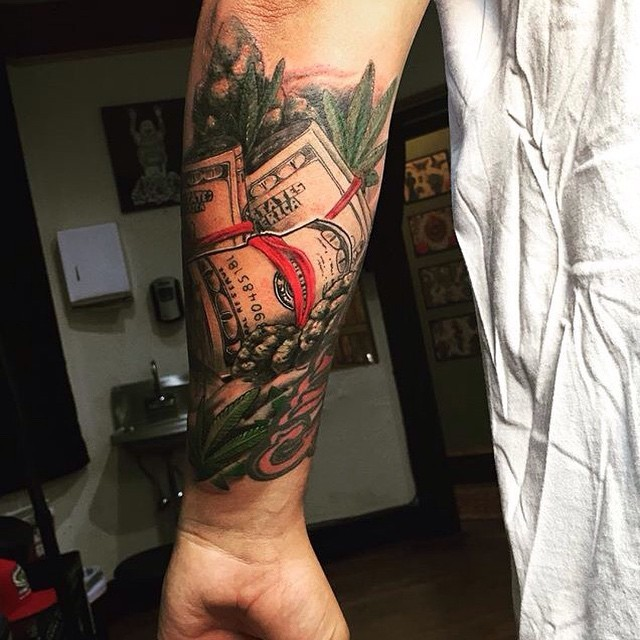 Nice colored detailed forearm tattoo of many dollar rolls