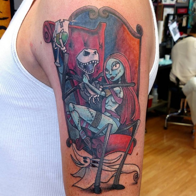 Nice colored monster cartoon couple tattoo on upper arm