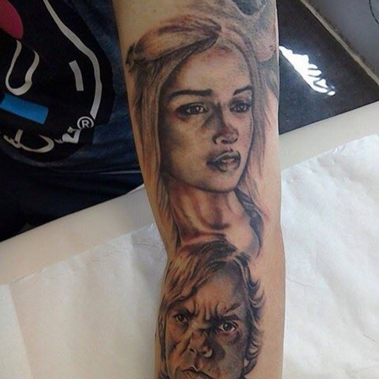 Nice colored natural looking various Game of Thrones heroes portraits tattoo on sleeve area