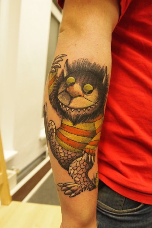 Nice colorful big forearm tattoo of fantasy funny monster