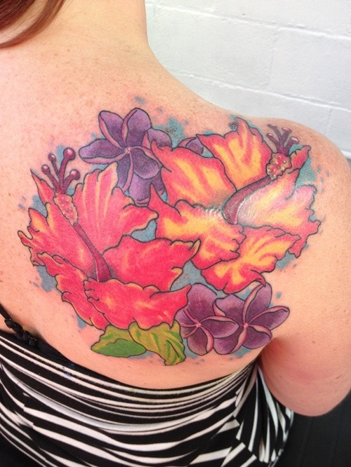 Nice coloured hibiscus flowers tattoo on shoulder