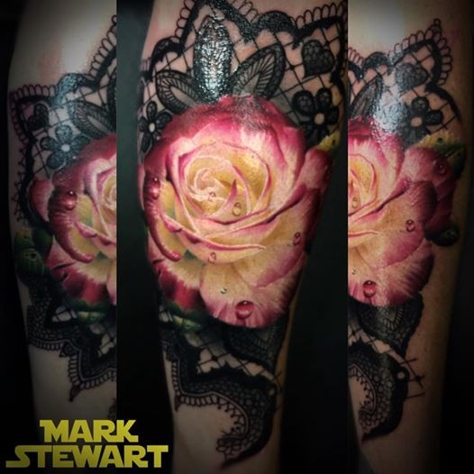 Nice combined and colored arm tattoo of cute rose with ornamental flowers