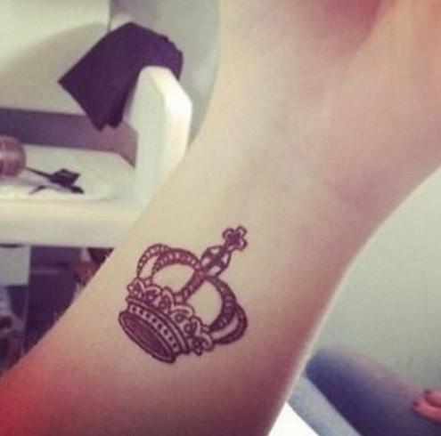 Nice crown tattoo on the wrist