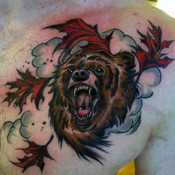 Nice designed and colored big brown bear with maple leaves tattoo on chest