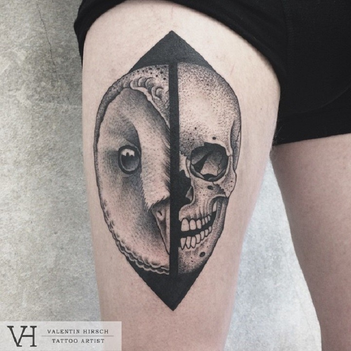 Nice designed by Valentin Hirsch thigh tattoo of split owl and human skull
