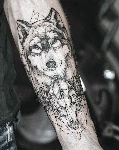 Nice dot style forearm tattoo of animal skull with wolf head