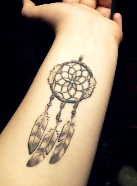Nice dream catcher tattoo on forearm