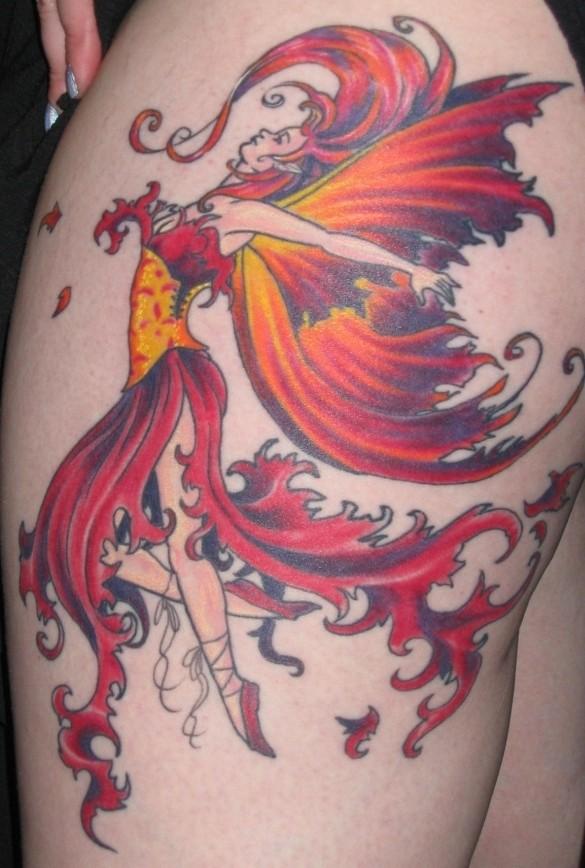 Nice fiery dancing fairy tattoo on thigh