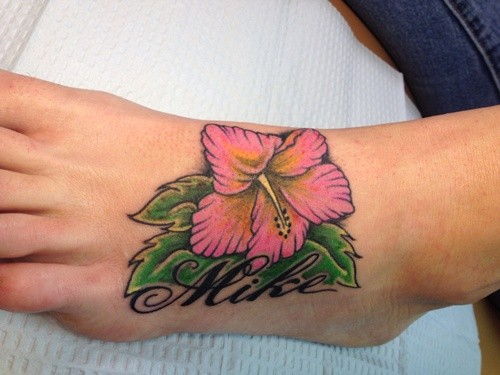 Nice hibiscus flower and name tattoo on foot