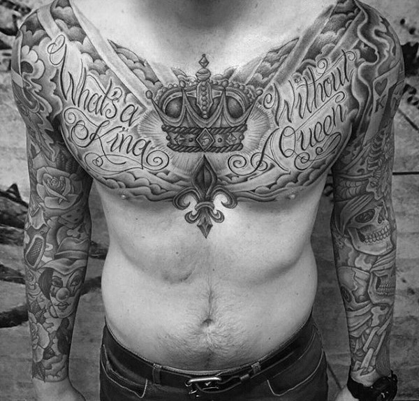 Nice looking black and white chest tattoo of lettering and crown