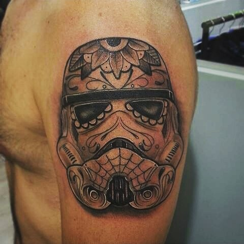 Nice looking black and white shoulder tattoo of Storm troopers helmet stylized with flowers