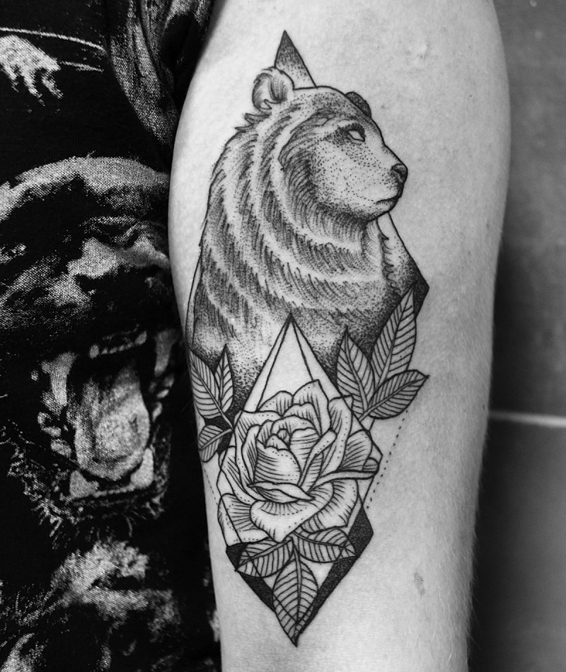 Nice looking black ink bear tattoo on arm with beautiful rose
