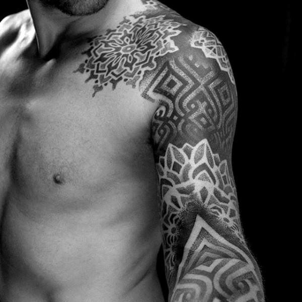 Nice looking black ink big ornamental tattoo on sleeve and shoulder