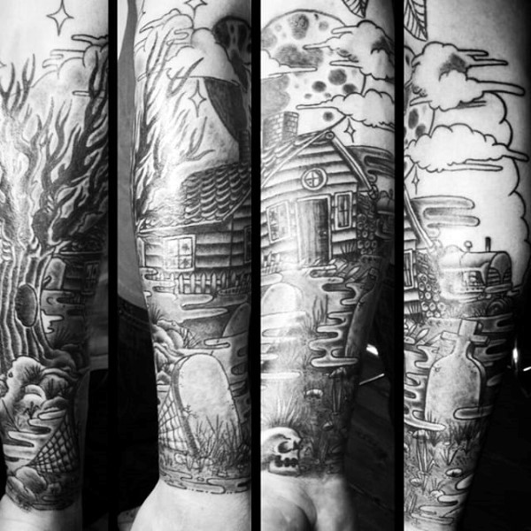 Nice looking black ink old house tattoo on forearm with cemetery and moon