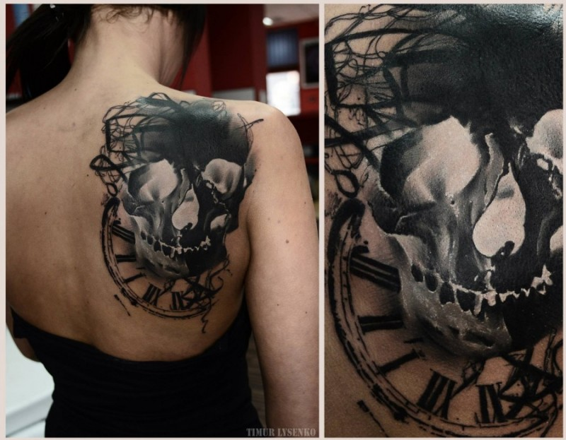Nice looking black ink skull with clock tattoo on back