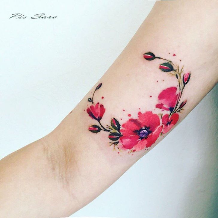 Nice looking colored arm tattoo of beautiful flowers