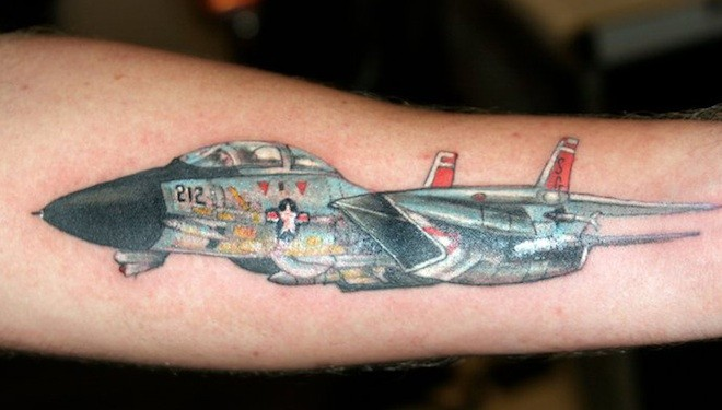 Nice looking colored arm tattoo of modern fighter plane