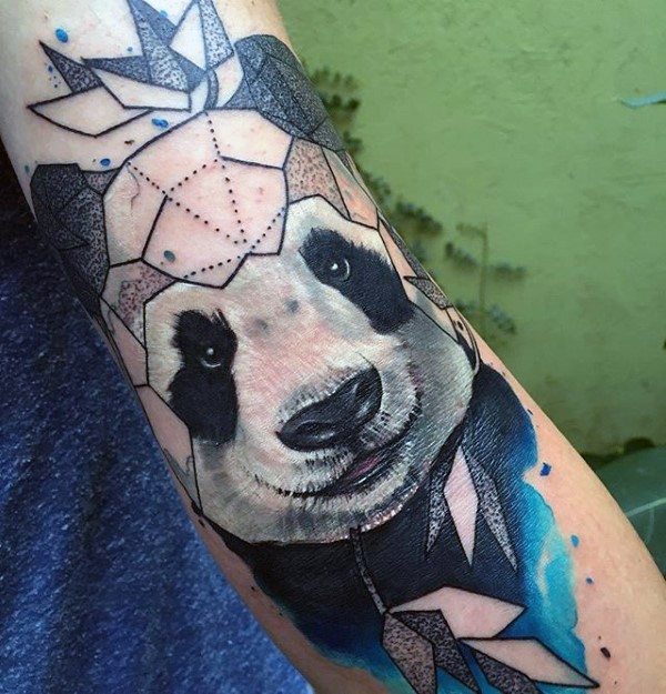Nice looking colored arm tattoo of panda bear with leaves