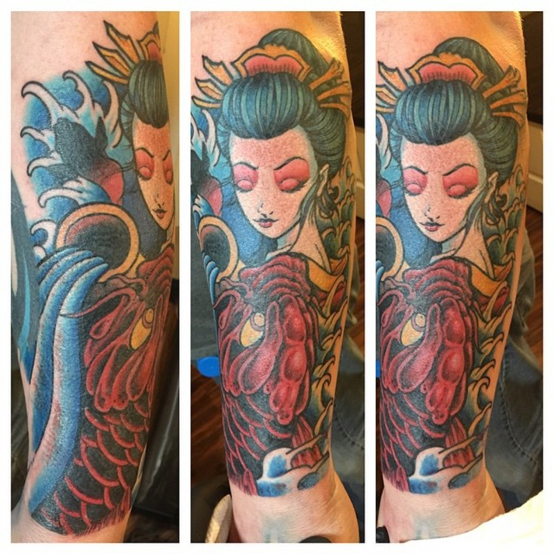 Nice looking colored Asian Aquarius woman with carp fish tattoo on forearm