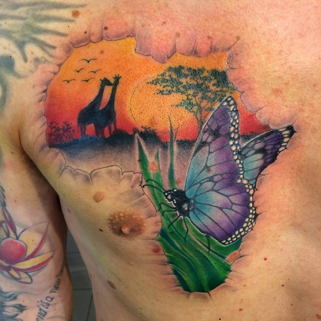 Nice looking colored chest tattoo of Africa map part with giraffe with butterfly