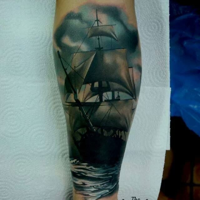 Nice looking colored forearm tattoo of sailing ship