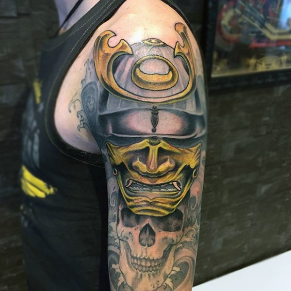 Nice looking colored samurai warrior helmet tattoo on shoulder combined with human skull