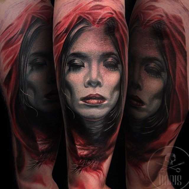 Nice looking colored shoulder tattoo of spectacular looking woman in red hood