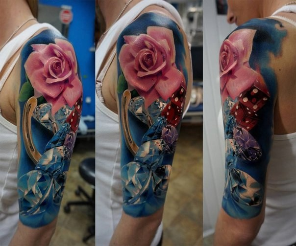 Nice looking colored shoulder tattoo of pink rose with diamonds