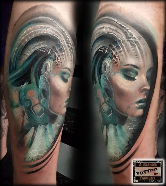 Nice looking colored shoulder tattoo of alien woman face