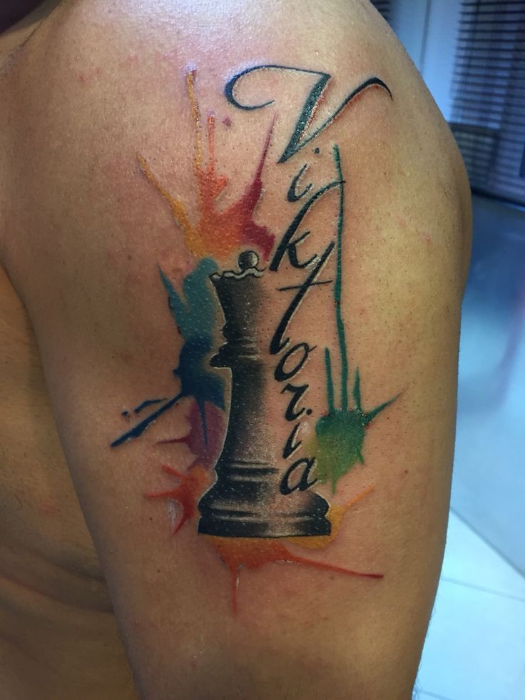 Nice looking colored shoulder tattoo of chess figure with lettering