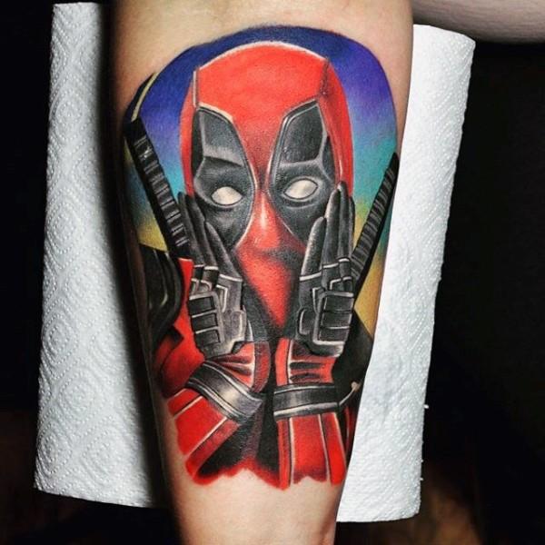 Nice looking colored sweet Deadpool tattoo on leg